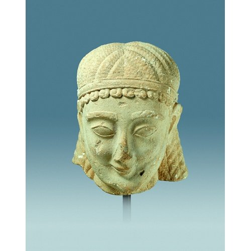National Archaeological Museum, Athens: Limestone head of a kouros. Inv. no 1832. Height: 30cm. Early 6th century BC. Photo Kapon Editions.