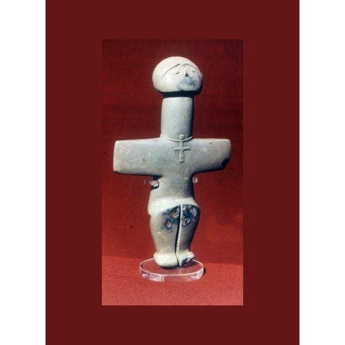Σχηματοποιημένο ειδώλιο από πικρόλιθο. Γυαλιά. Ύ. 15,3 εκ. 3000 π.Χ. περίπου. Κυπριακό Μουσείο.