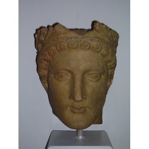Male head, limestone, from Potamia, Nicosia, Cyprus Museum Potamia 55, by permission of the Department of Antiquities of Cyprus (photo G. Koiner).