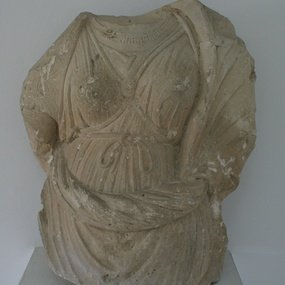 Female torso, limestone, from Arsos, Nicosia, Cyprus Museum D 296, Larnaca District Museum, by permission of the Department of Antiquities of Cyprus (photo G. Koiner).