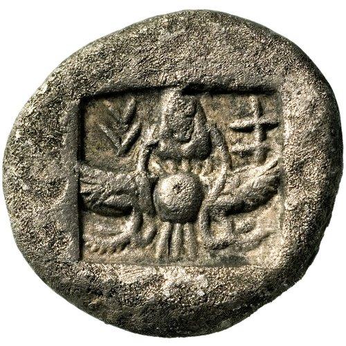 Οπισθότυπος νομίσματος με αναπαράσταση φτερωτού δίσκου.