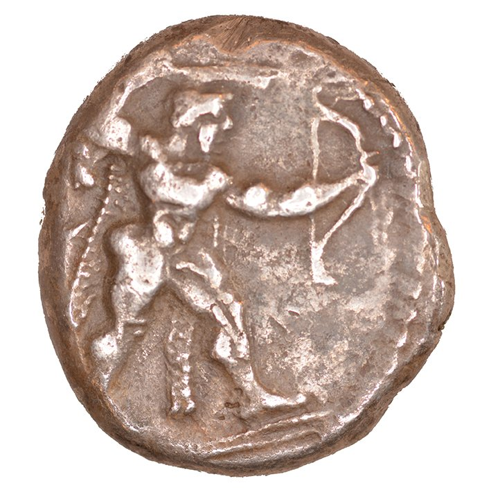 Εμπροσθότυπος 'SilCoinCy A1047, acc.no.: KP 1185.109. Silver coin of king Ozibaal of Kition 450 - 425 BC. Weight: 0.78 g, Axis: 3h, Diameter: 22mm. Obverse type: Heracles advancing r. holding club and bow. Obverse symbol: -. Obverse legend: - in -. Reverse type: Lion devouring stag r.. Reverse symbol: -. Reverse legend: l'zb'l in Phoenician. '-', 'Du classement des séries chypriotes'.