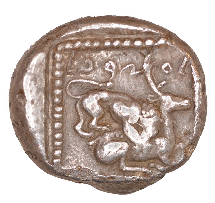 Οπισθότυπος 'SilCoinCy A1047, acc.no.: KP 1185.109. Silver coin of king Ozibaal of Kition 450 - 425 BC. Weight: 0.78 g, Axis: 3h, Diameter: 22mm. Obverse type: Heracles advancing r. holding club and bow. Obverse symbol: -. Obverse legend: - in -. Reverse type: Lion devouring stag r.. Reverse symbol: -. Reverse legend: l'zb'l in Phoenician. '-', 'Du classement des séries chypriotes'.