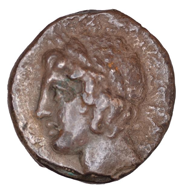 Οπισθότυπος 'SilCoinCy A1100, acc.no.: KP 929.42. Silver coin of king  of  . Weight: 6.14g, Axis: 12h, Diameter: 18mm. Obverse type: Aphrodite head r. with turreted crown. Obverse symbol: -. Obverse legend: NK in Greek. Reverse type: Apollo head l. with laurel wreath. Reverse symbol: -. Reverse legend: BA in Greek. '-'.