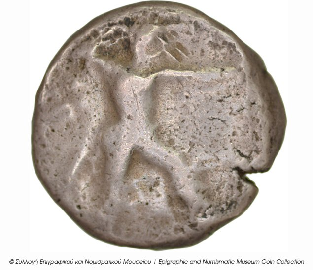 Εμπροσθότυπος 'SilCoinCy B5, Kyrou Collection, acc.no.: ΒΠ 1989 - 5. Silver coin of king Ozibaal of Kition 450 - 425 BC. Weight: 10.76g, Axis: 7h, Diameter: 22mm. Obverse type: Herakles walking r.. Obverse symbol: -. Obverse legend: - in -. Reverse type: Lion devouring stag r.. Reverse symbol: -. Reverse legend: zb' in Phoenician. 'Les monnaies chypriotes dans la collection d'Adonis Kyrou'.